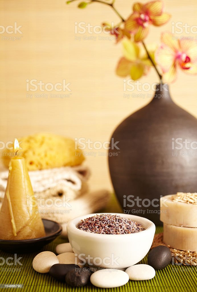 Spa still life of lavender flowers and candle in bathroom royalty-free stock photo
