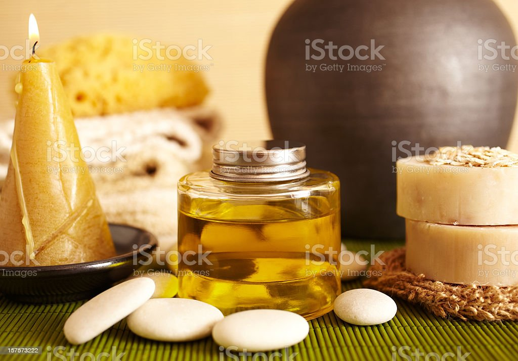 Spa still life of massage oil and candel in bathroom stock photo