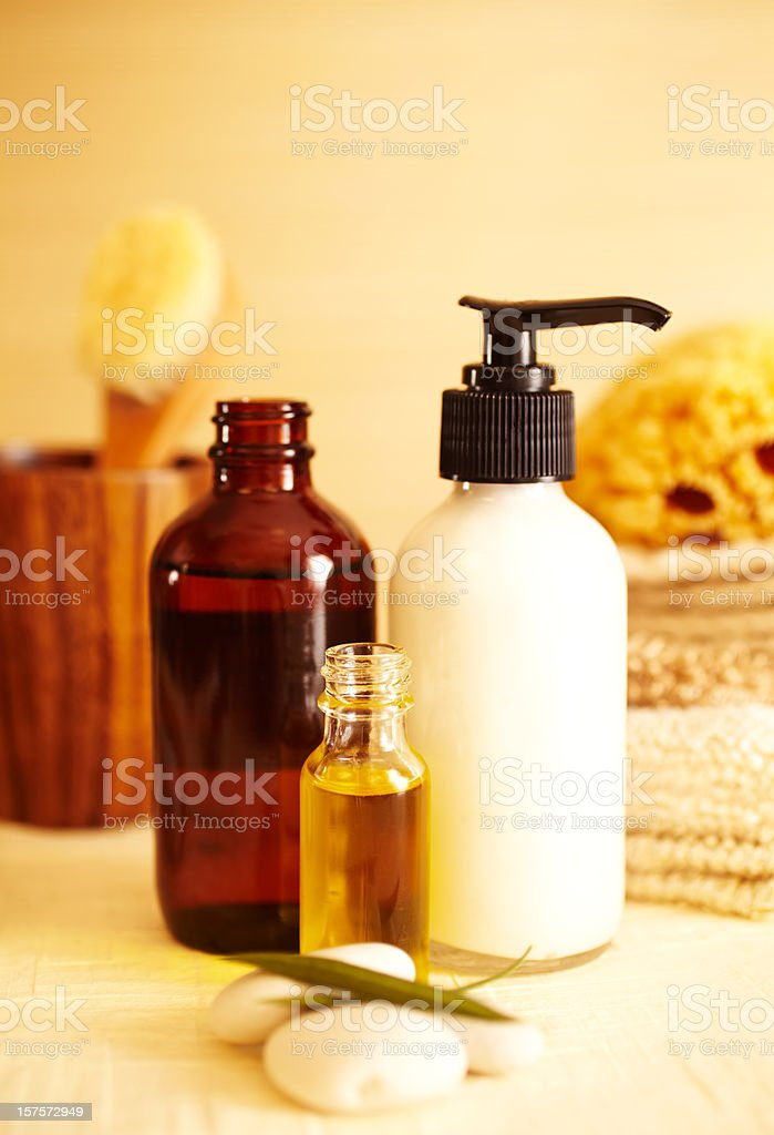 Spa still life of moisturizer and oil in bathroom stock photo