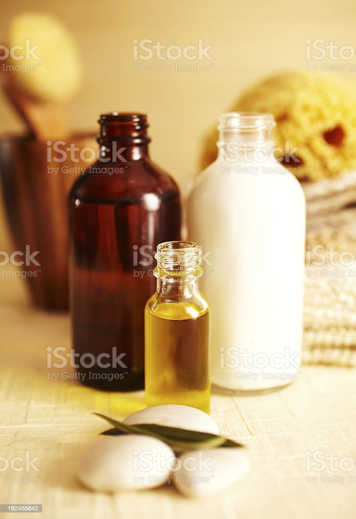 Spa still life of moisturizer and oil in bathroom royalty-free stock photo