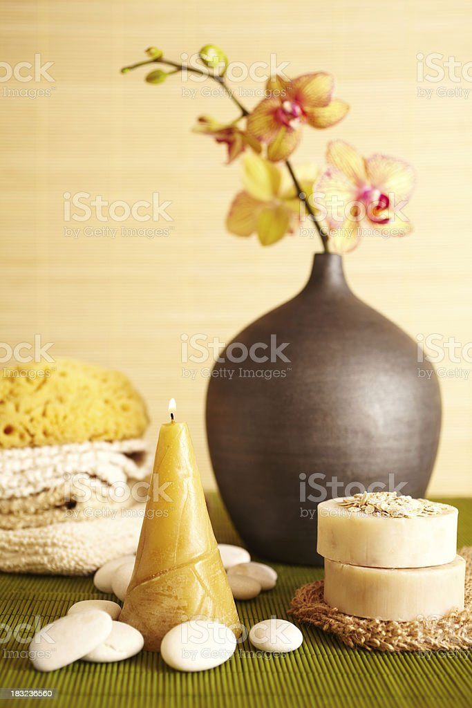 Spa still life of orchid flower and candel in bathroom stock photo