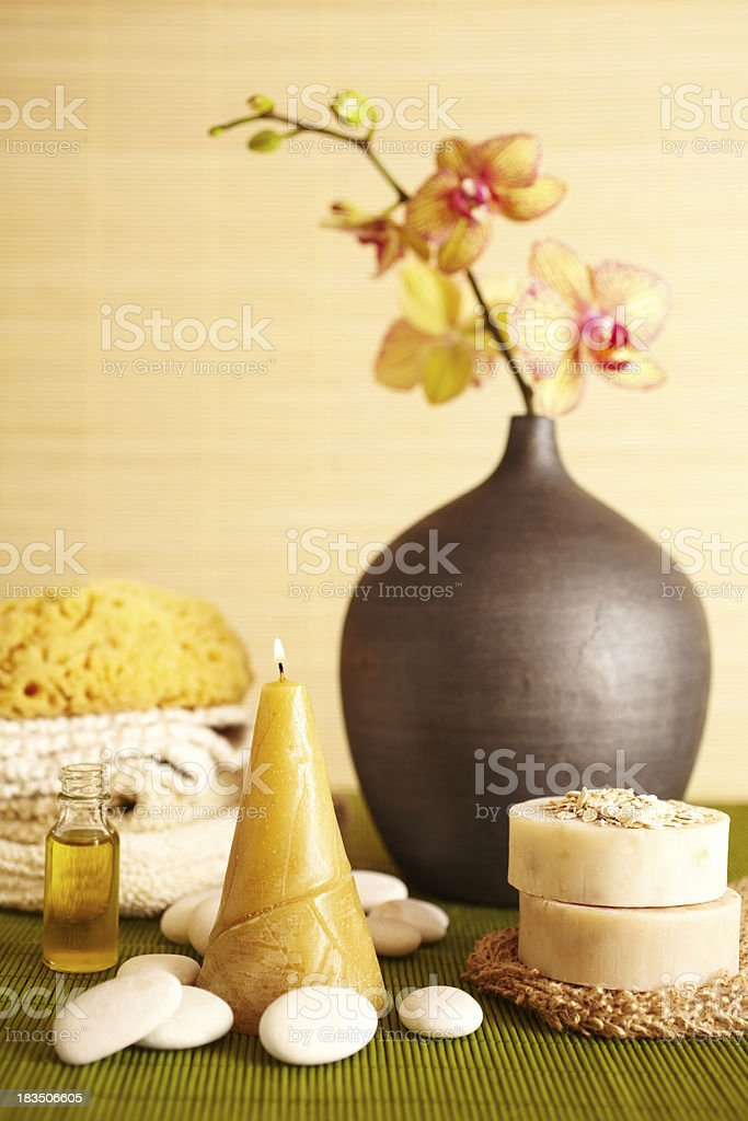 Spa still life of orchid flower and candel in bathroom royalty-free stock photo