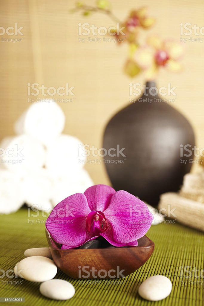 Spa still life of orchid flower and towels in bathroom royalty-free stock photo