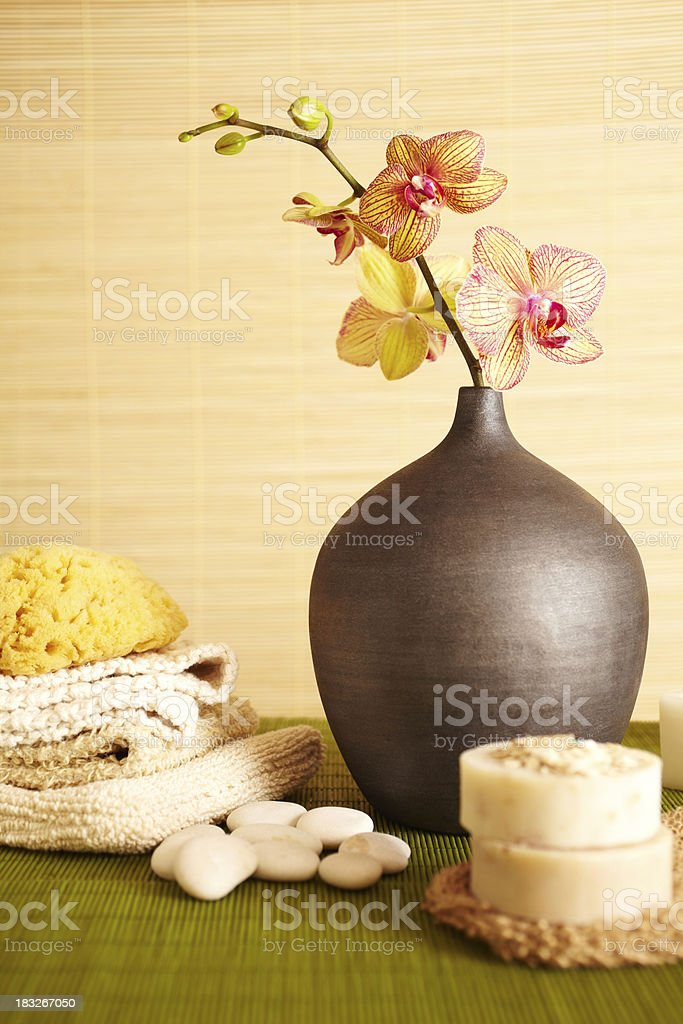 Spa still life of orchid flower in bathroom stock photo