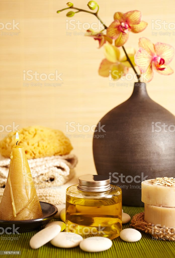 Spa still life of orchid flower, massage oil in bathroom stock photo