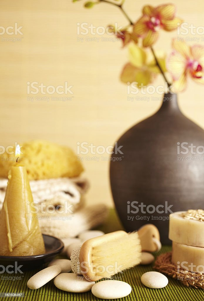 Spa still life of pumice stone brush and candle stock photo