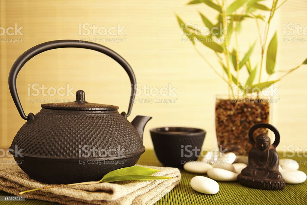 Spa still life of tea, bamboo, and buddha royalty-free stock photo