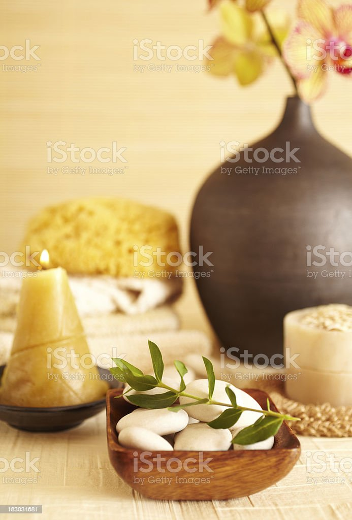 Spa still life of white rocks with green leaf stock photo
