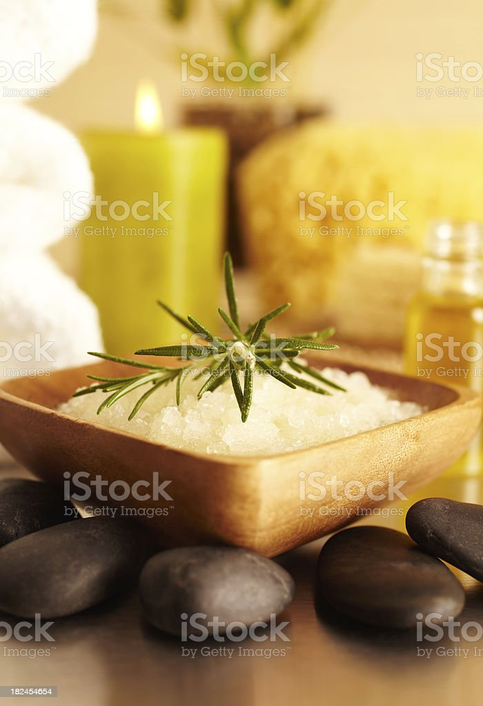 Spa still life sea salt scrub, candle, essential oil royalty-free stock photo