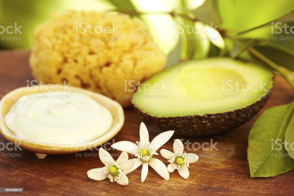 Spa still life with avocado mud mask in a bowl stock photo