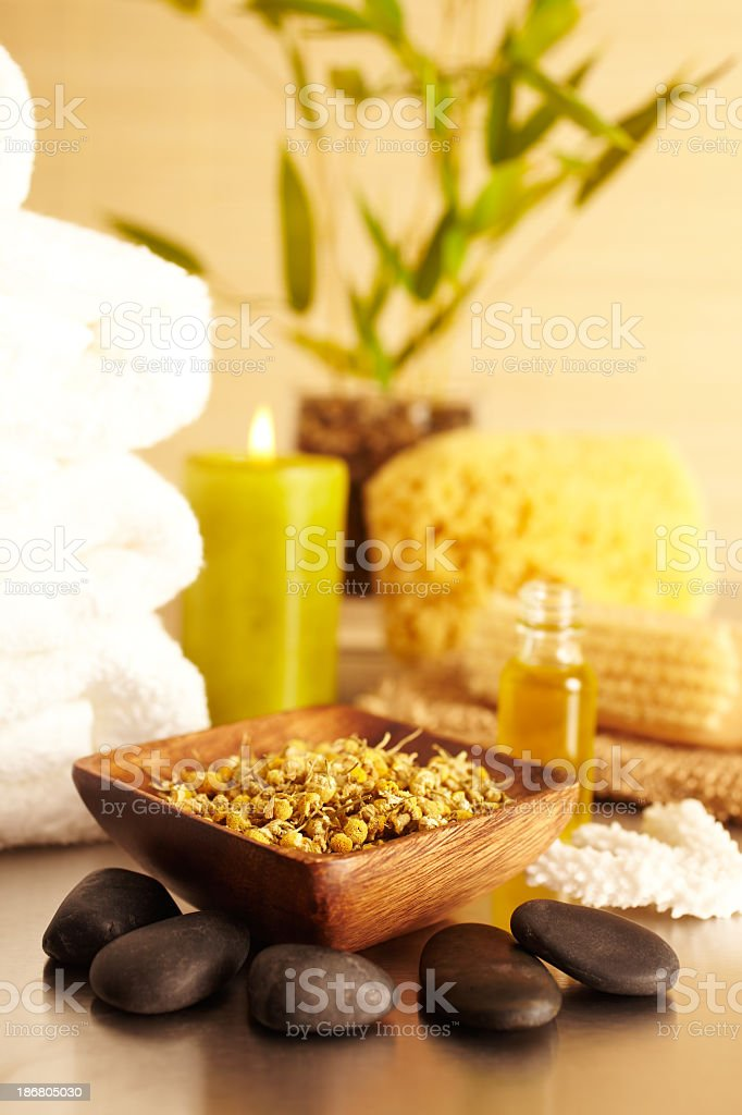 Spa still life with Camomile, candle, essential oil stock photo