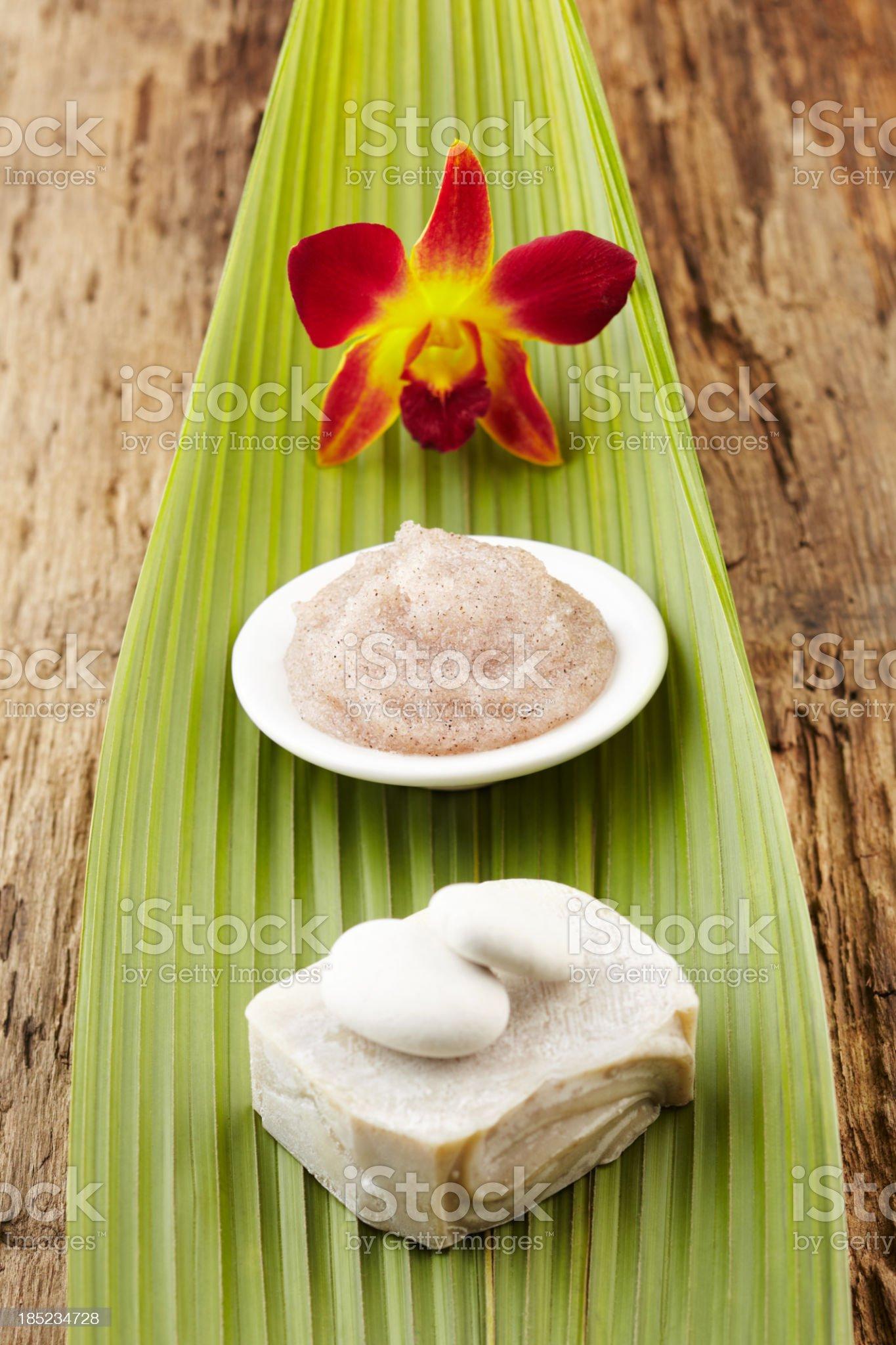 Spa still life with flower, sugar scrub, soap, green leaf royalty-free stock photo