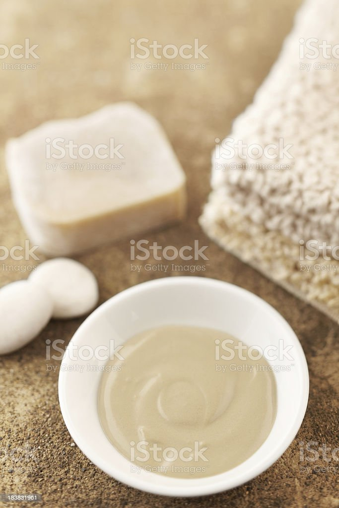 Spa still life with mud mask and bar of soap stock photo