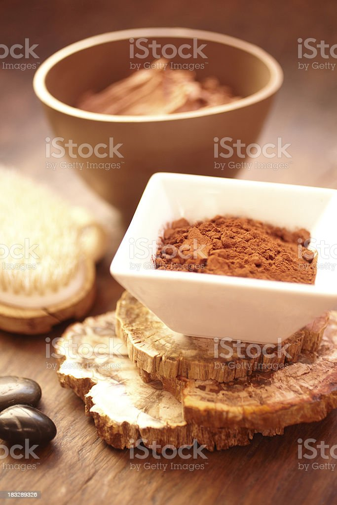 Spa still life with mud mask and exfoliating brush royalty-free stock photo