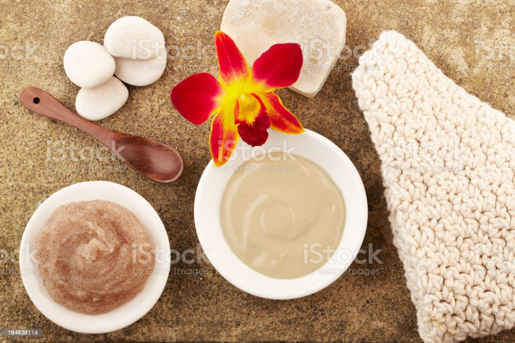 Spa still life with mud mask and salt scrub stock photo