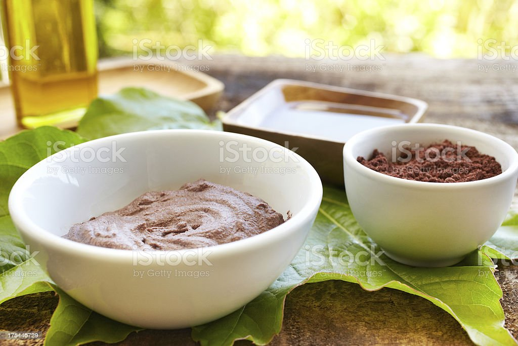 Spa still life with mud mask powder and massage oil stock photo
