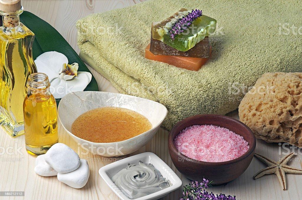 Spa still life with mud mask, salt scrubbing, massage oil royalty-free stock photo