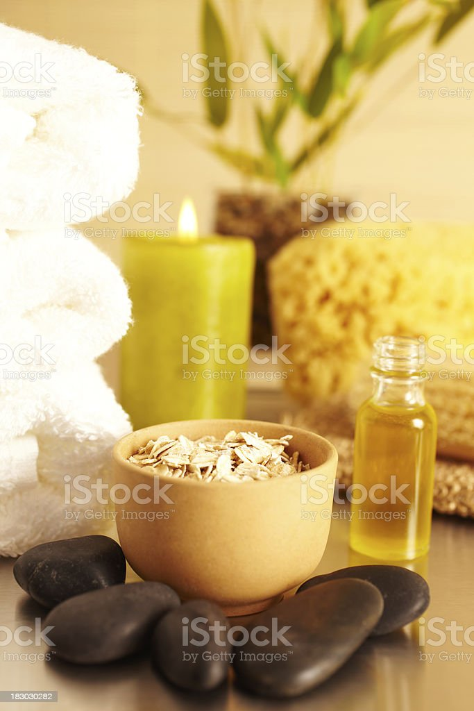 Spa still life with oatmeal, candle, essential oil royalty-free stock photo
