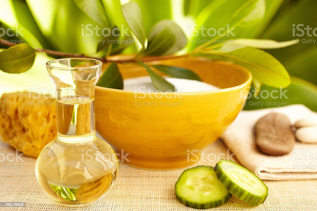 Spa still life with organic mud mask and massage oil stock photo