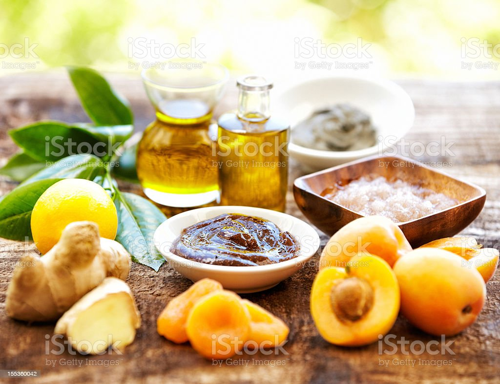 Spa still life with organic scrub, massage oil, apricots, ginger royalty-free stock photo