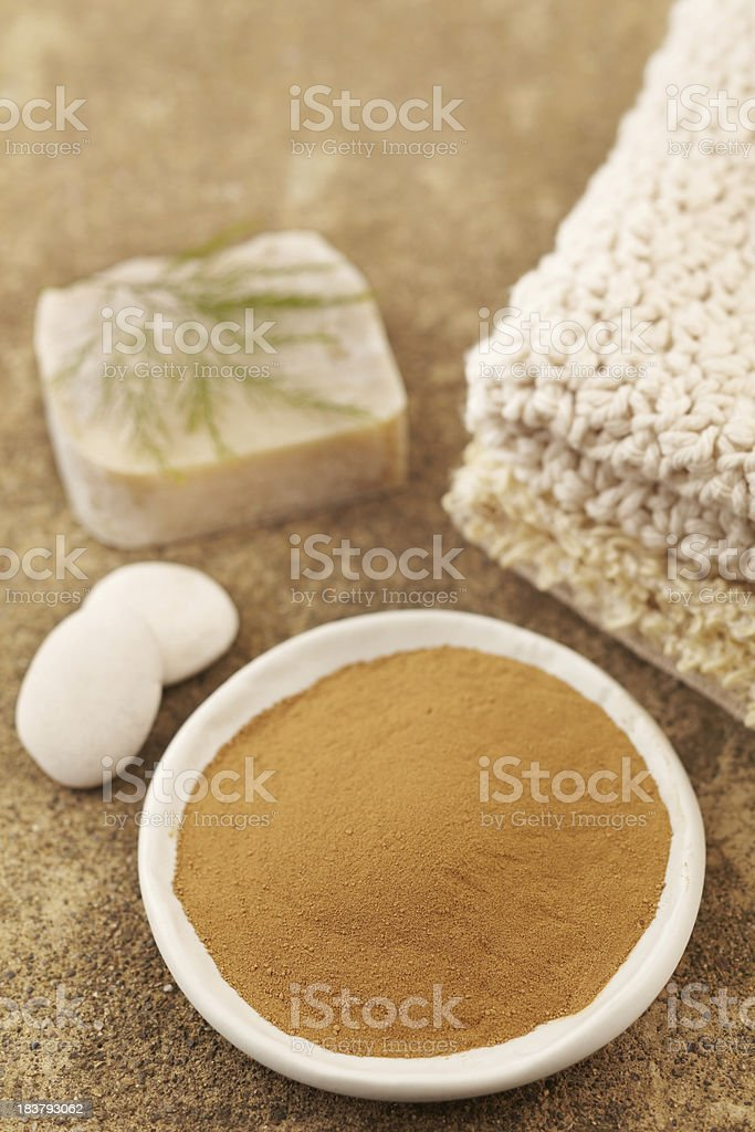 'Spa still life with powder mud mask, soap, fern' stock photo