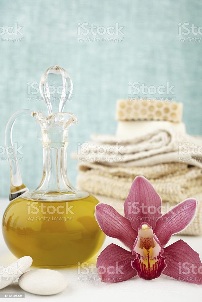 Spa still life with purple orchid, oil massage, soap, washcloths stock photo