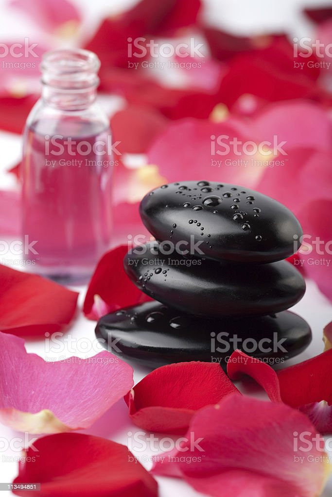 spa stones, essential oil and rose petals royalty-free stock photo