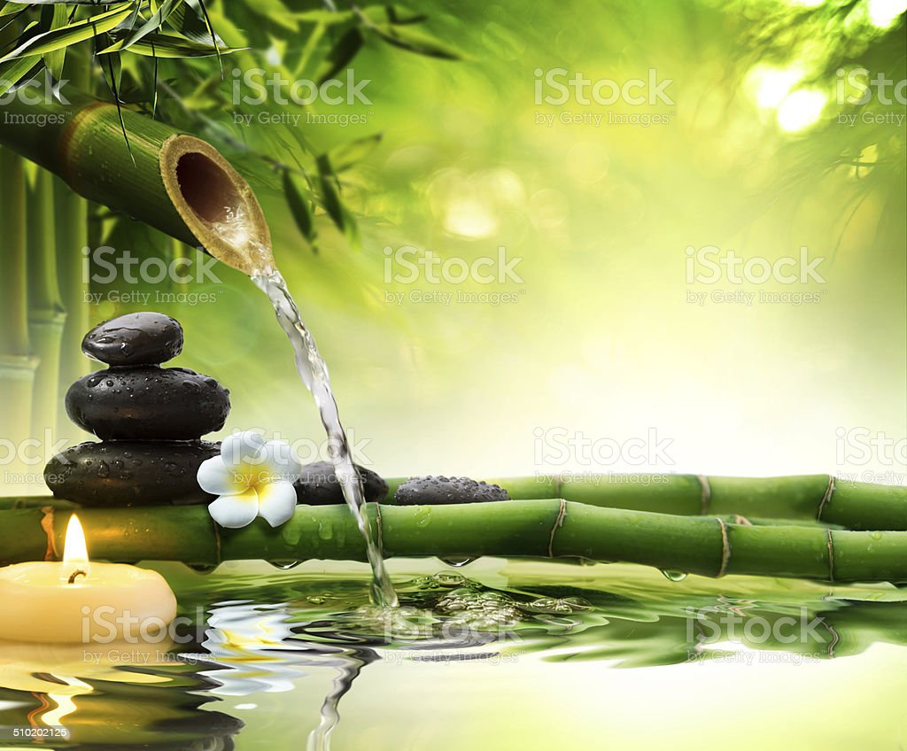 spa stones in garden with flow water stock photo