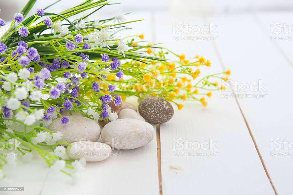 Spa stones on white wooden table stock photo