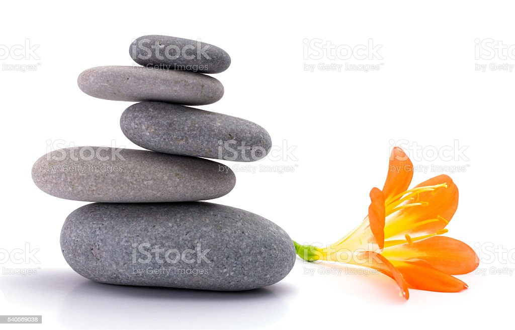 Spa stones with flower stock photo