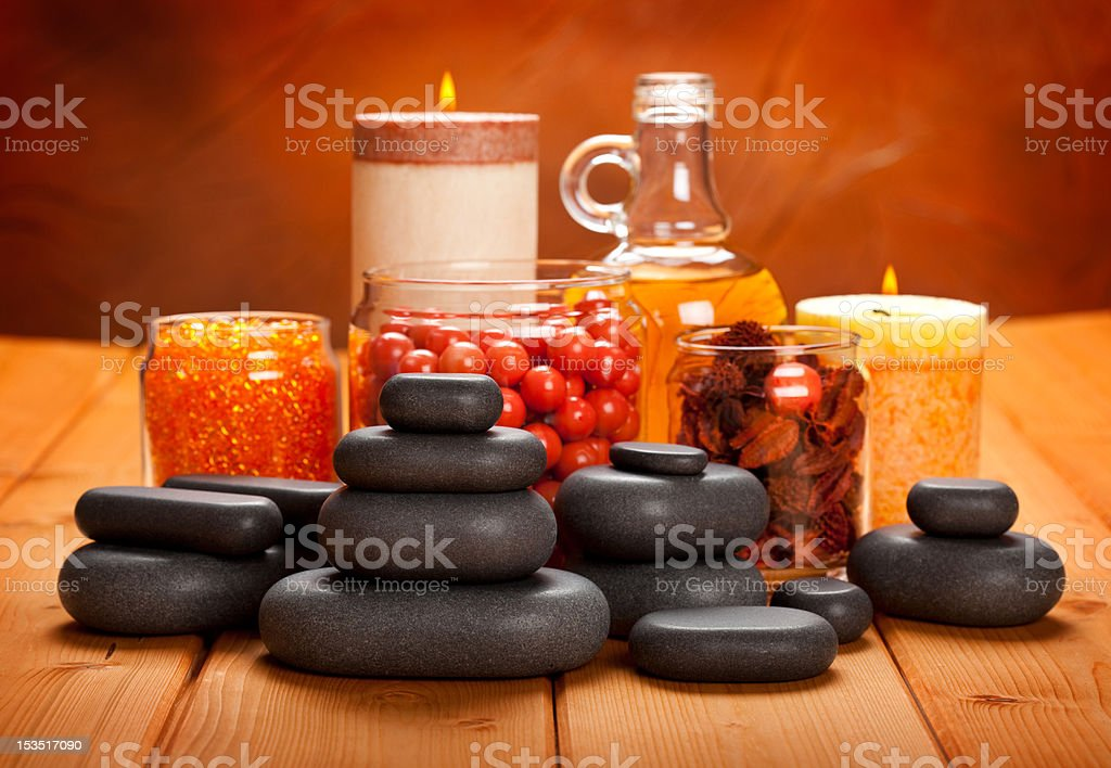 Spa supplies - essential oil, bath salt and massage stones royalty-free stock photo