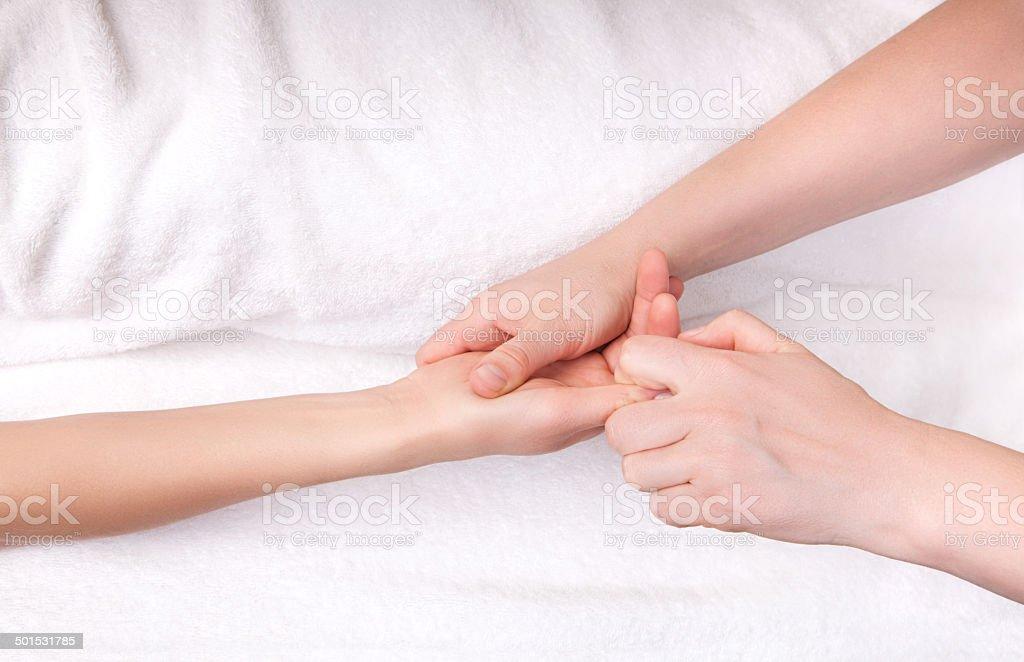 Spa therapist doing a finger massage stock photo