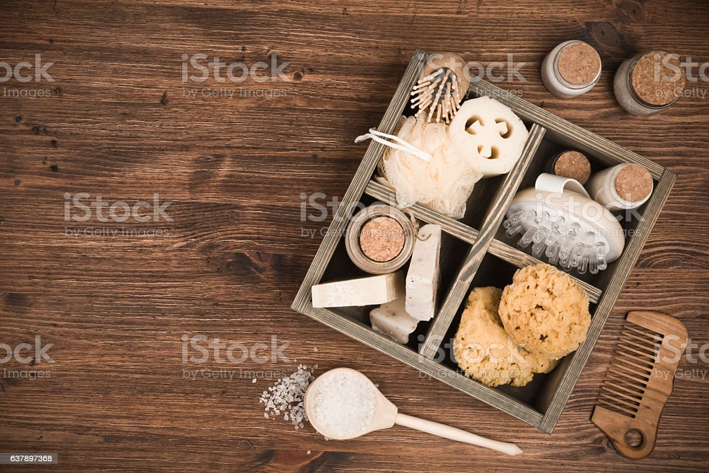 Spa threatment and massage products in box on wooden background stock photo