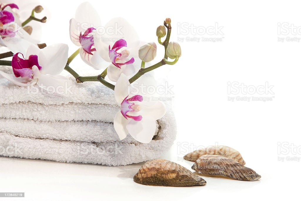 Spa towels, orchid and seashells royalty-free stock photo