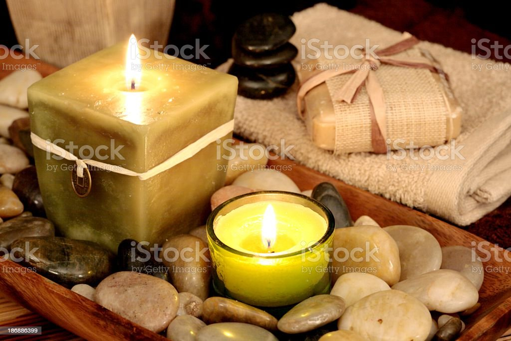 Spa Tranquility with candles, stones, soap in neutral colors stock photo