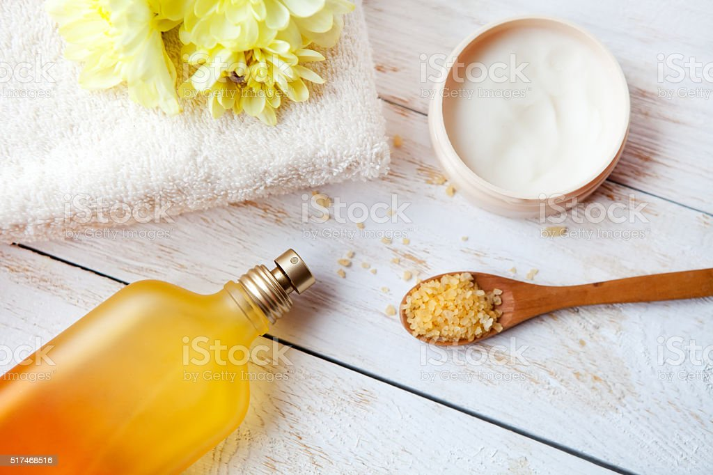 spa treatment set with  aroma oil  on wooden table stock photo