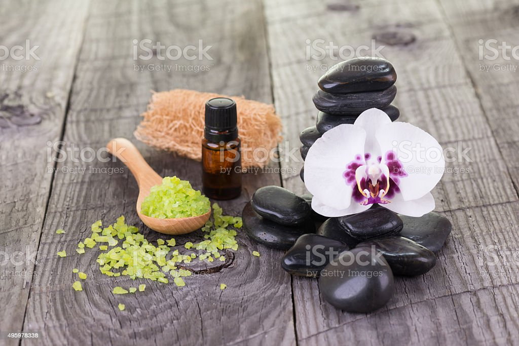 Spa treatment with bath salt, essential oil and black stones stock photo