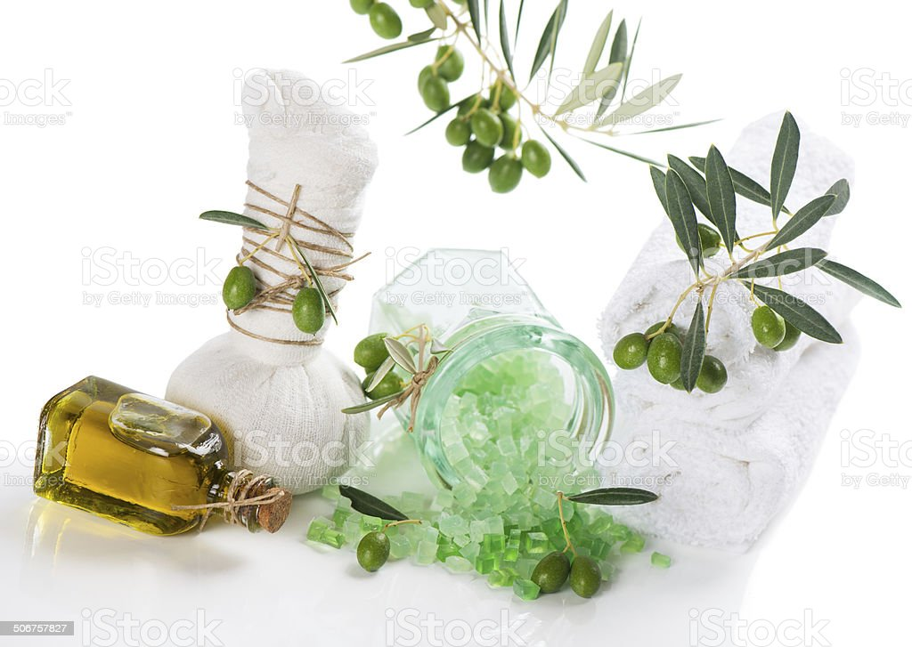 Spa treatment with olives and towels stock photo