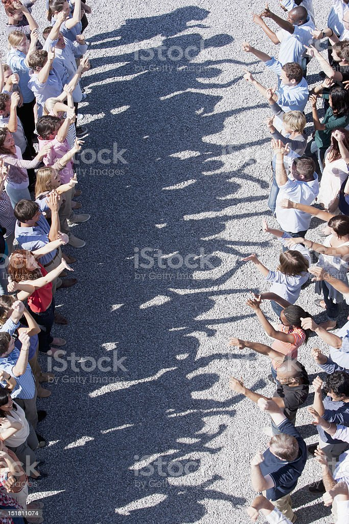 Space between crowd of cheering people royalty-free stock photo