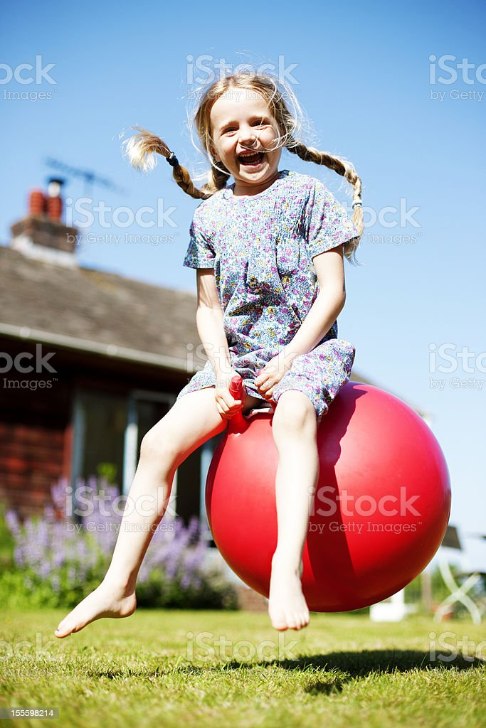 Space hopping girl stock photo