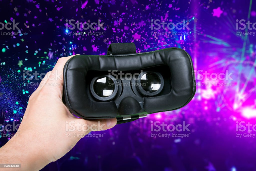 Space image in virtual reality glasses. Hands holding switched-on vr headset. Modern technology, innovation, cyberspace, entertainment concept stock photo
