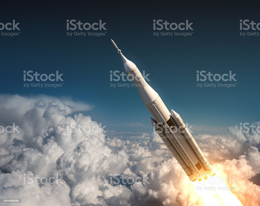 Space Launch System Flying In The Clouds stock photo