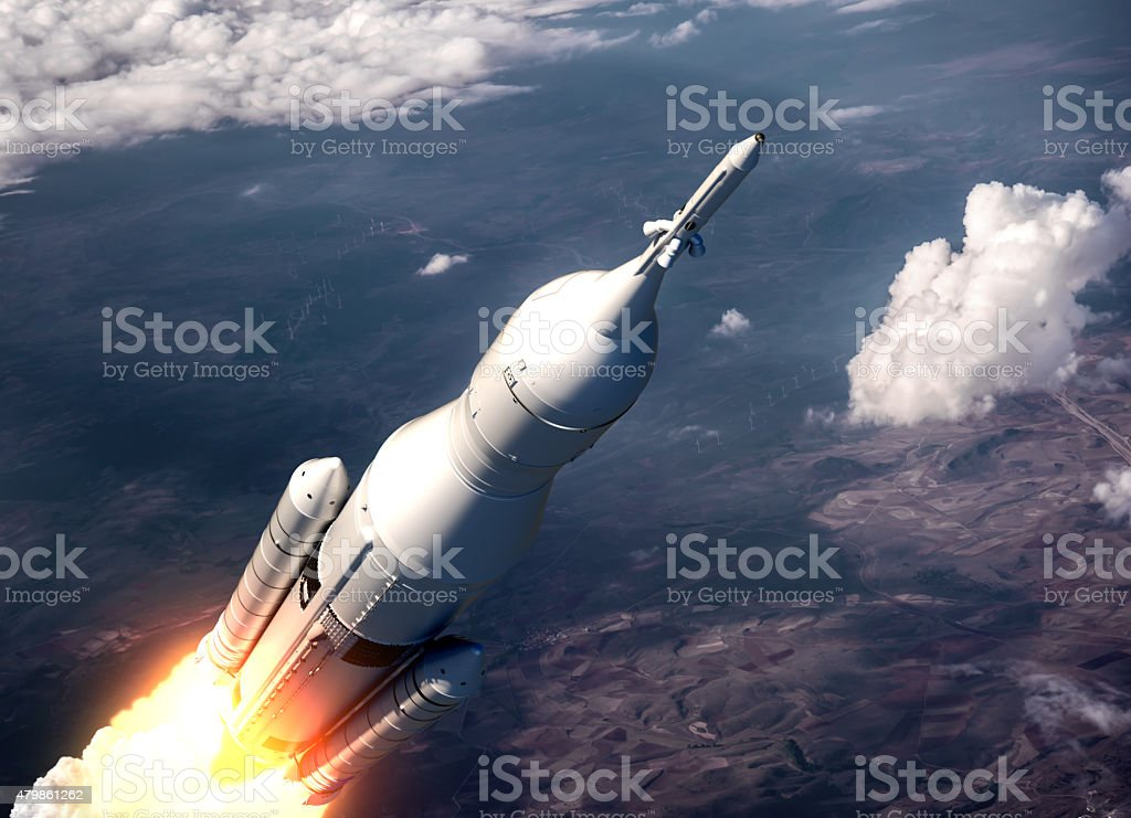 Space Launch System Flying Over The Clouds stock photo