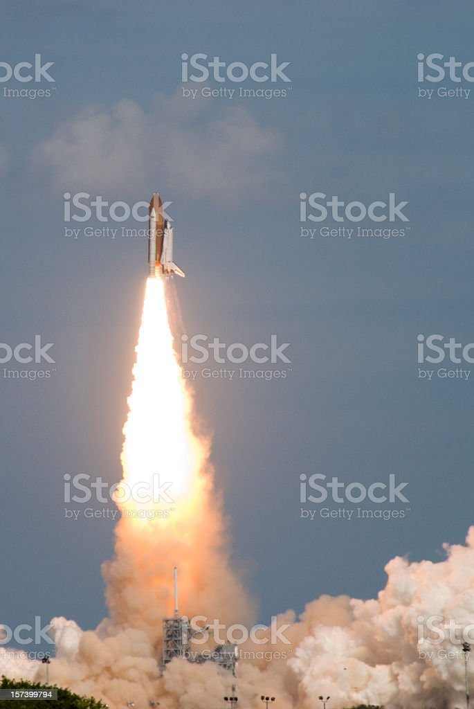 A space shuttle being launched into the sky stock photo
