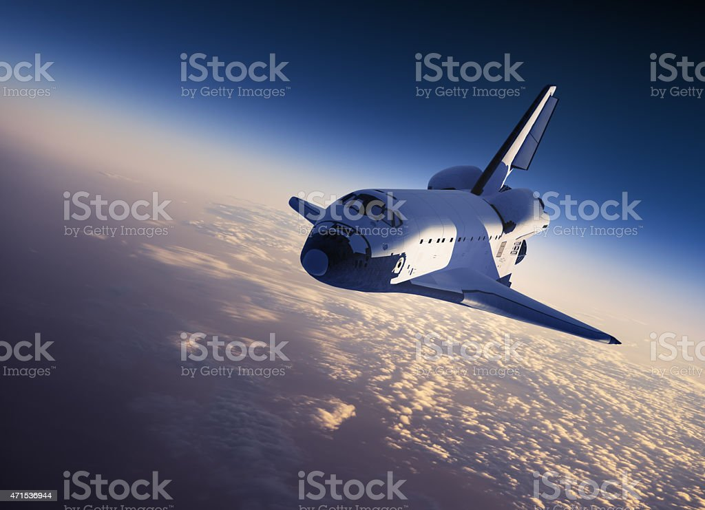 A space shuttle flying in space stock photo