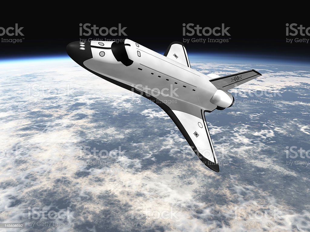 space shuttle flying over earth royalty-free stock photo