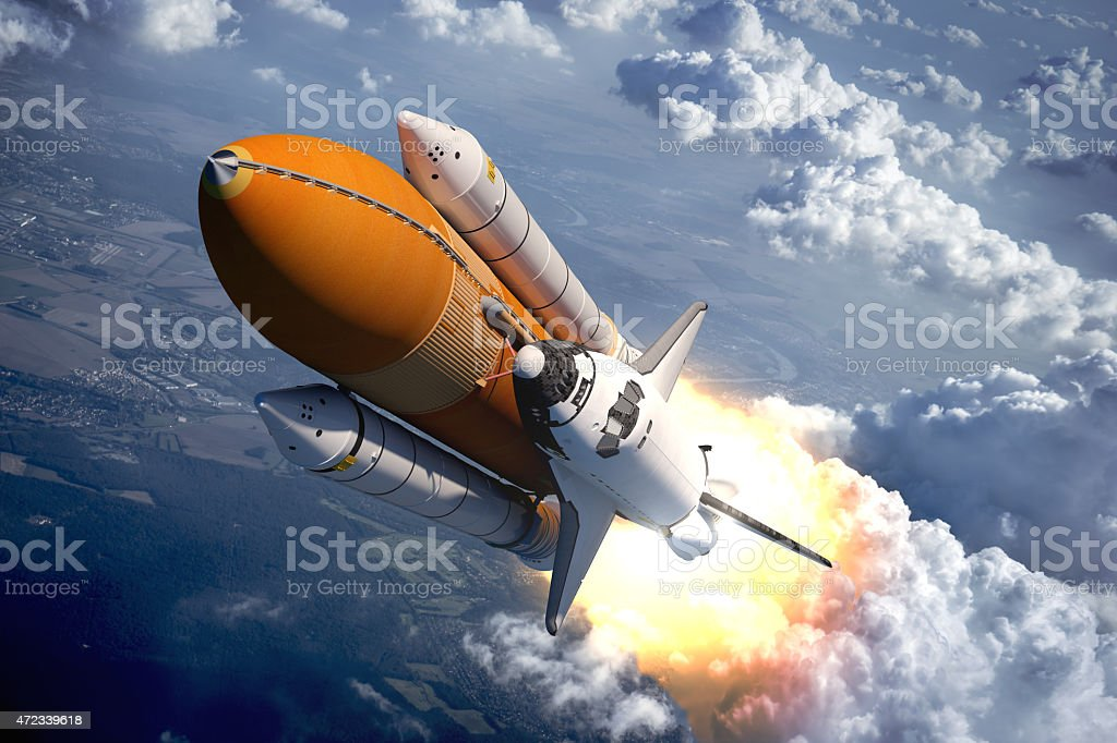 Space Shuttle Flying Over The Clouds stock photo