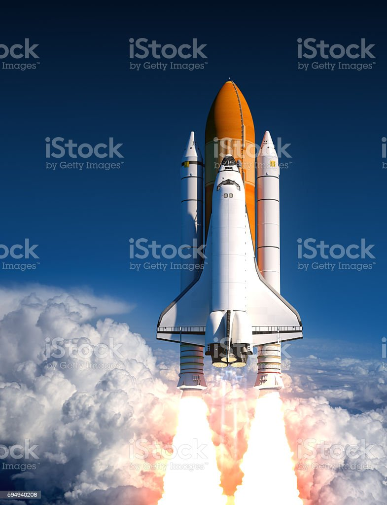 Space Shuttle Launch In The Clouds stock photo