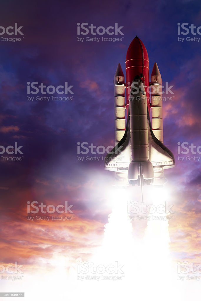 Space shuttle taking off into the sunset stock photo