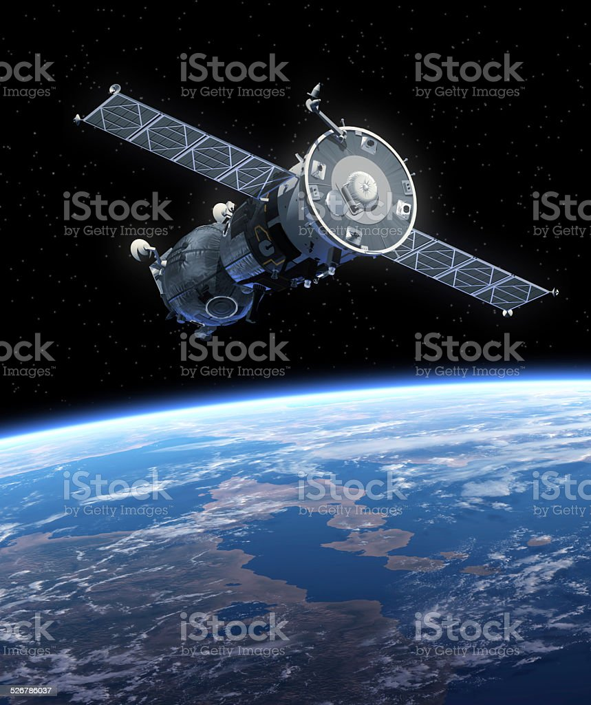Spacecraft Orbiting Earth stock photo
